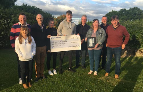 Members of the Cassidy and Walsh families present a cheque for €10, 800 to the Friends of Carrick Cancer in memory of the late Ciara Walsh RIP.