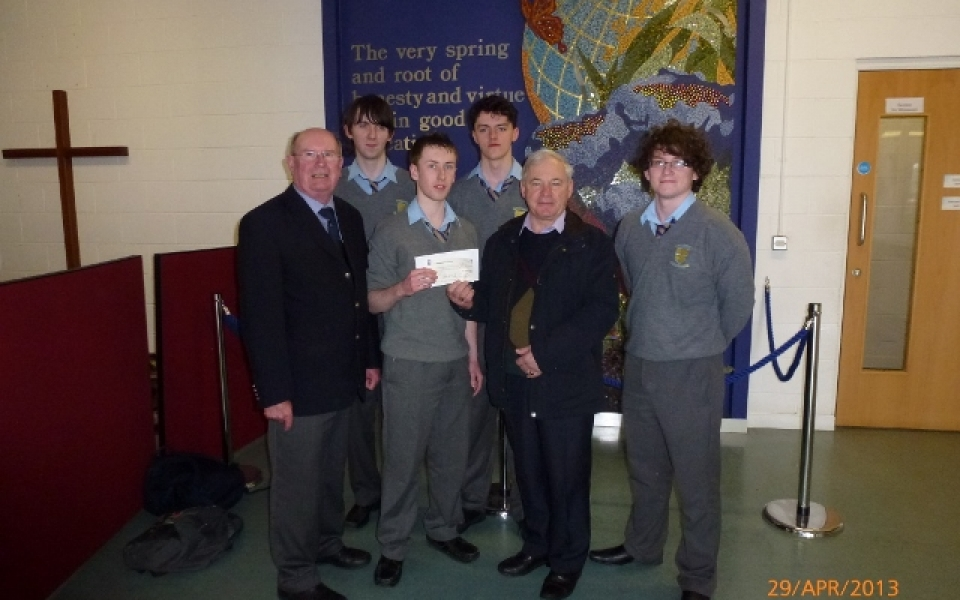 high school boys present cheque for 1760.59 640×480