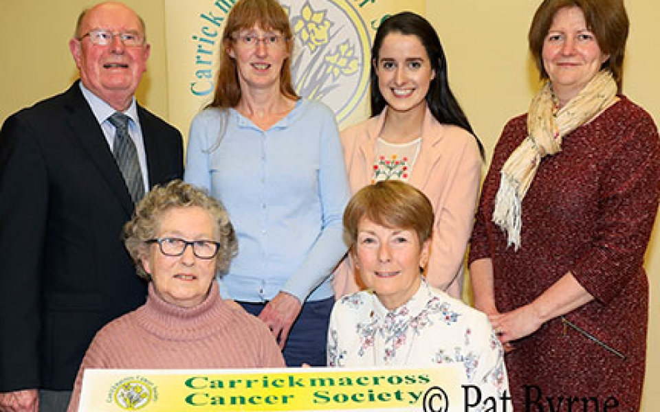 Tess O'Connor, Sinead Finnegan, Lisa Russell, Bernie Ruth,  present to Michael McMahon and Marion Maggs (Carrickmacross Cancer Society).