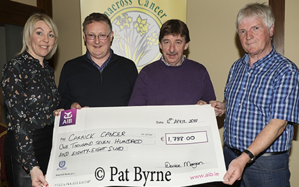 Denise Meegan makes a presentation of proceeds raised from the Dublin City Marathon, to the Friends of Carrickmacross Cancer; Paraic Ruth, Francie McDonald and Pat McNally.